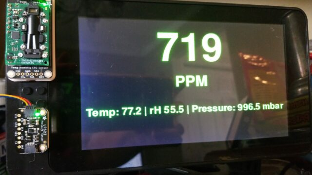 a 7-inch screen displays the output of a python script that reads data from CO2 and pressure sensors, and then displays that information on the screen.